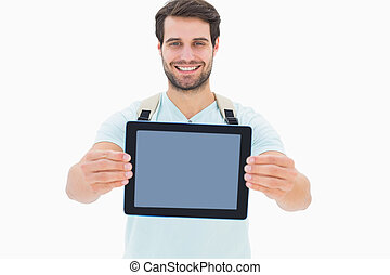 Handsome student showing his tablet pc