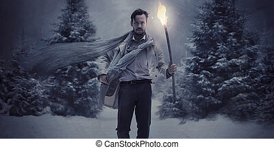 Handsome stylish man holding torch