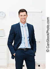 Handsome stylish young businessman standing smiling...