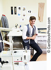 Handsome Tailor Posing in Atelier