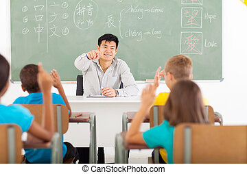 handsome teacher teaching Chinese in classroom