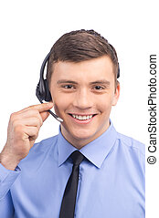 handsome technical support operator working on white. businessman with headset portrait at bright call center and smiling