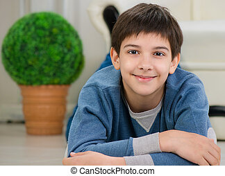 Handsome teen boy lying on floor
