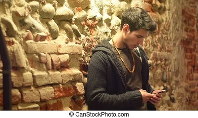 Handsome trendy man talkiing on cell phone