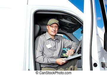 Handsome truck driver. - Smiling truck driver in the car. ...