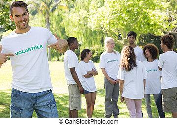 Handsome volunteer pointing at tshirt