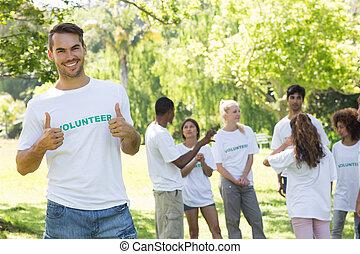 Handsome volunteer showing thumbs up