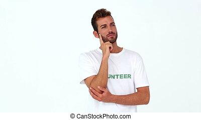 Handsome volunteer thinking on white background