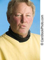 handsome whistling middle age senior man worn turtleneck shirt