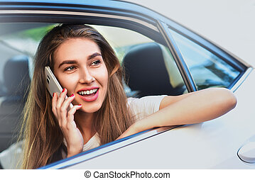 Handsome woman sitting in a car.