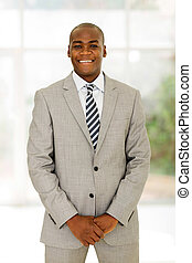 young african american businessman standing in office
