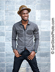 Handsome young african american man smiling with hat