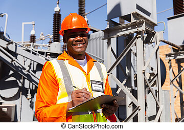 young african electrical engineer holding clipboard