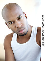 Handsome young black man in white shirt