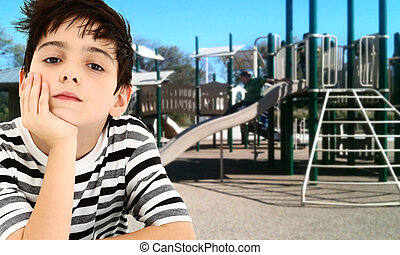 Handsome Young Boy Child Bored at Park.