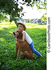 Handsome Young Boy Playing with dog