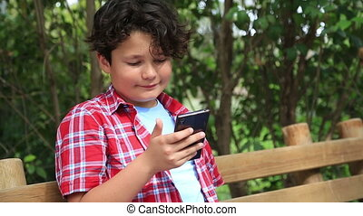 Handsome young boy with smartphone