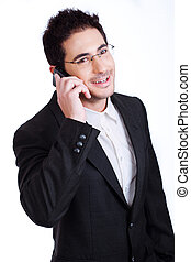 Handsome young business man talking over phone