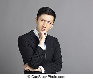 handsome young business man thinking