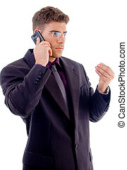 handsome young businessman busy with cell phone