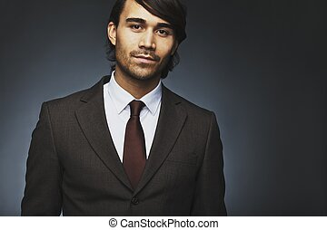Handsome young businessman in suit