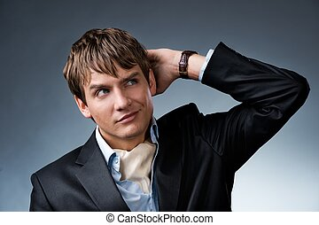 Handsome young businessman isolated on grey background