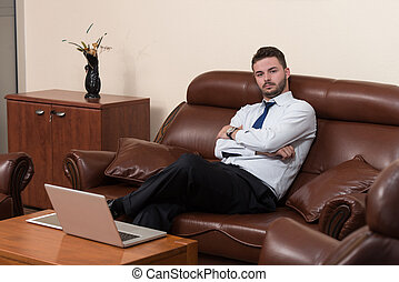 Handsome Young Businessman Portrait In His Office