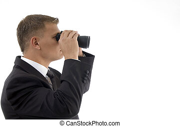handsome young businessman using a pair of binoculars