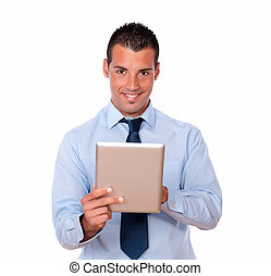 Handsome young businessman using his tablet pc