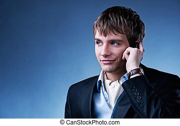 Handsome young businessman with a mobile phone