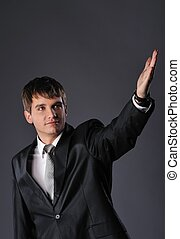 Handsome young businessman with outstretched hand