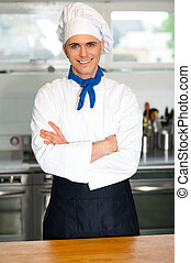 Handsome young chef posing in uniform