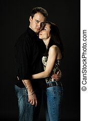 handsome young couple posing in studio