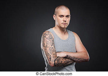handsome young guy standing and looking. tattooed attractive...