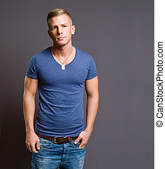 Handsome young male model. - Portrait of a friendly smiling...