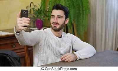 Handsome young man doing selfie at home - Handsome smiling...