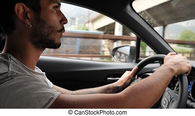 Handsome Young Man Driving a Car