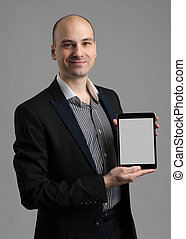 Handsome young man holding a digital tablet
