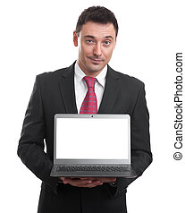 Handsome young man holding a laptop