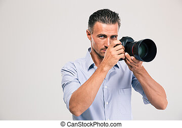 Handsome young man holding camera