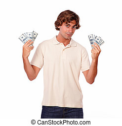 Handsome young man holding cash dollars
