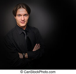 Handsome young man in a black shir