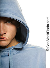 Handsome young man in a hood isolated on white background