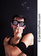 handsome young man in a strange glasses smoking cigarette
