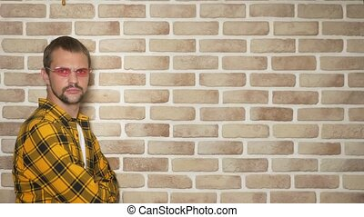 handsome young man in a yellow checkered shirt and pink...