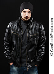 Handsome young man in black leather jacket