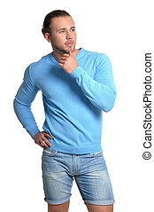 Handsome young man in blue sweater