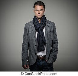 Handsome young man in casual jacket and neck scarf