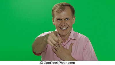 Handsome young man in pink shirt laughing. Chroma key