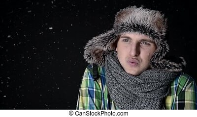 man in winter cloth with snow